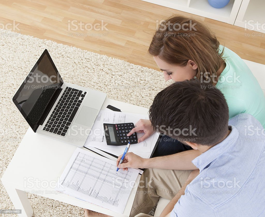 Young couple calculating budget stock photo