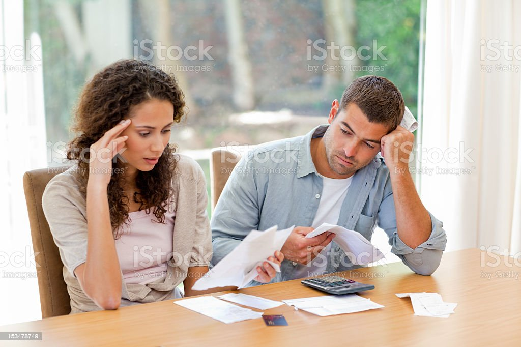 Young couple calculating their domestic bills stock photo