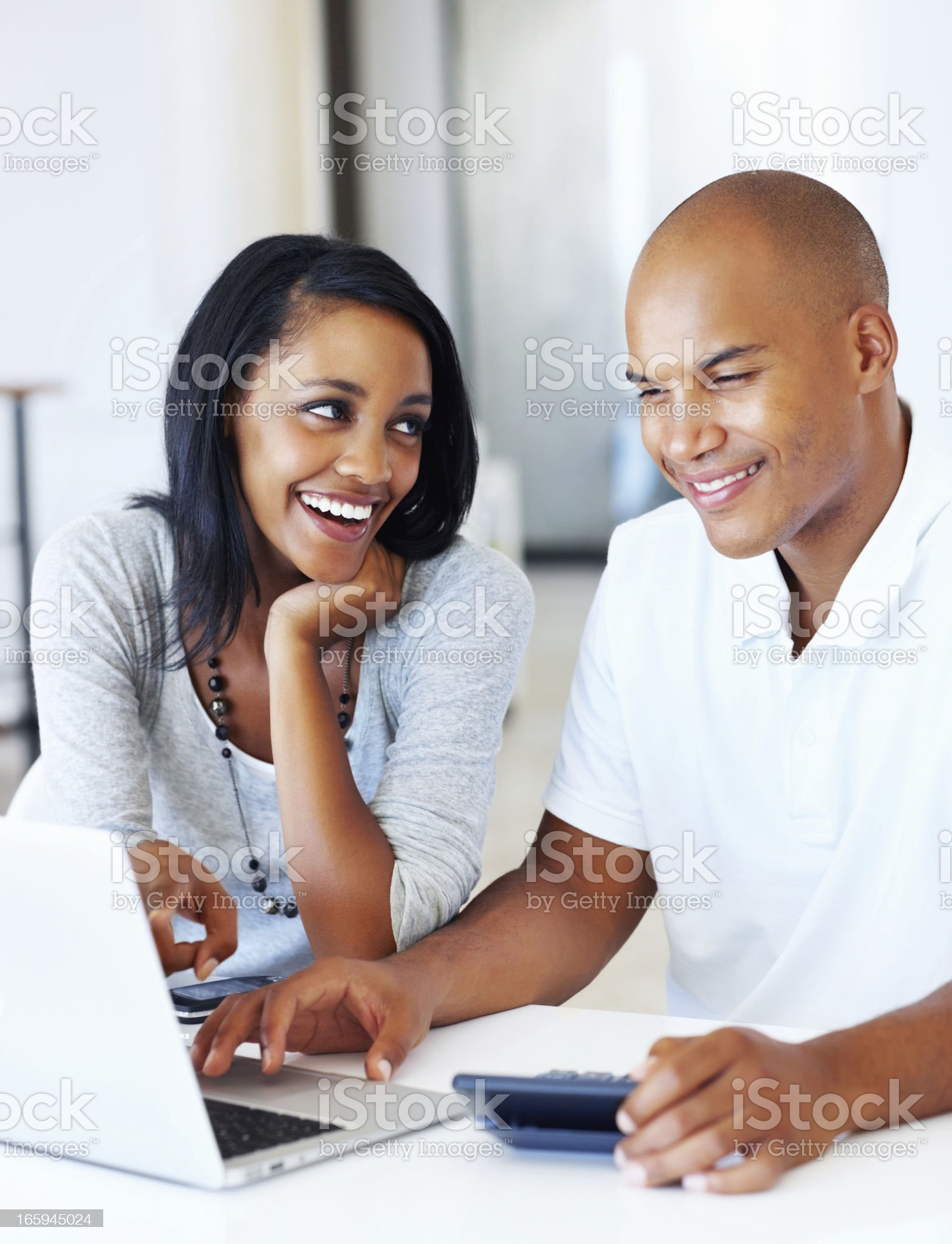 Young couple calculating their expenses royalty-free stock photo