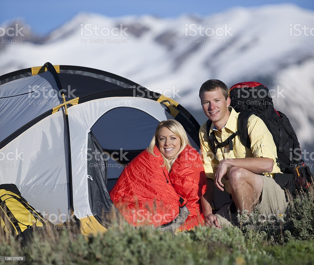 Young Couple Camping In Mountains With Tent And Backpack royalty-free stock photo