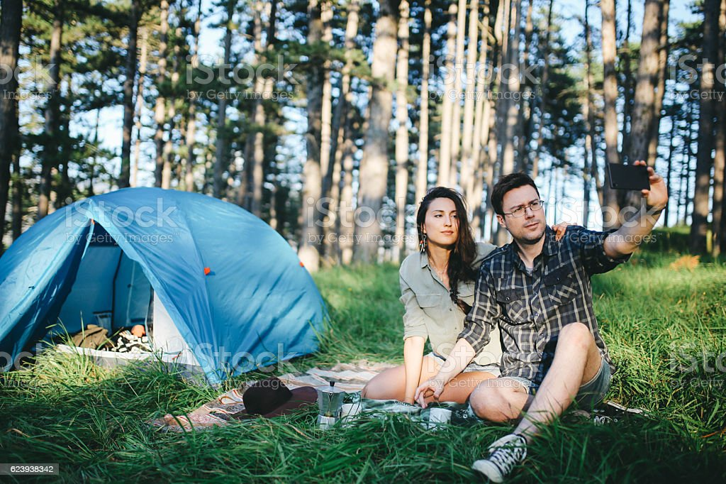Young couple camping stock photo
