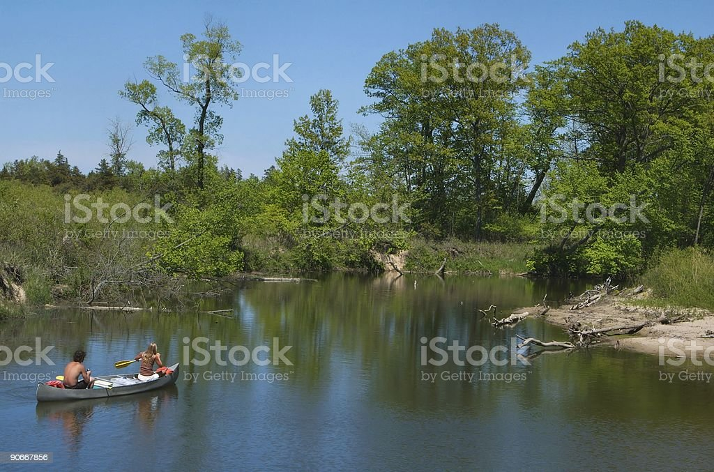 Young Couple Canoeing on Scenic River royalty-free stock photo