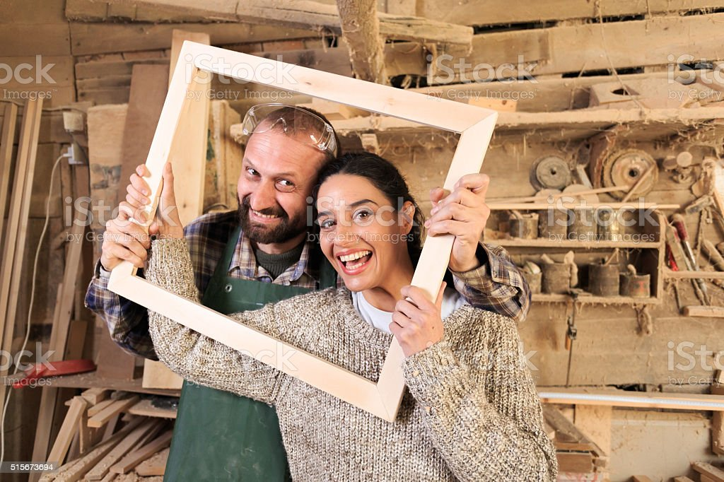 Young couple carpenter artists stock photo