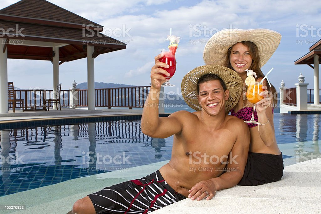 Young couple cheering with a cocktail royalty-free stock photo