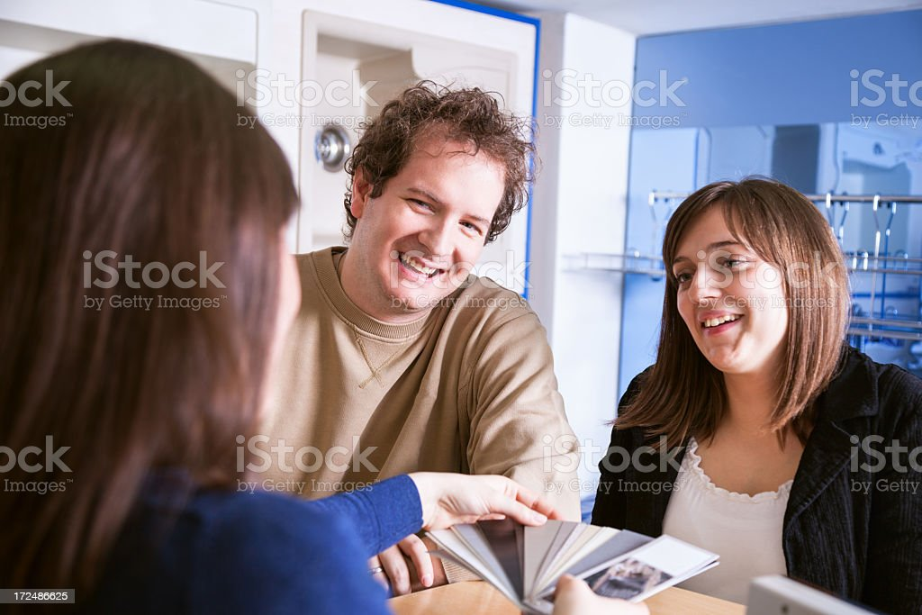 Young couple choosing a new kitchen in showroom royalty-free stock photo