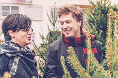Young Couple Choosing Christmas Tree, City Market, Europe