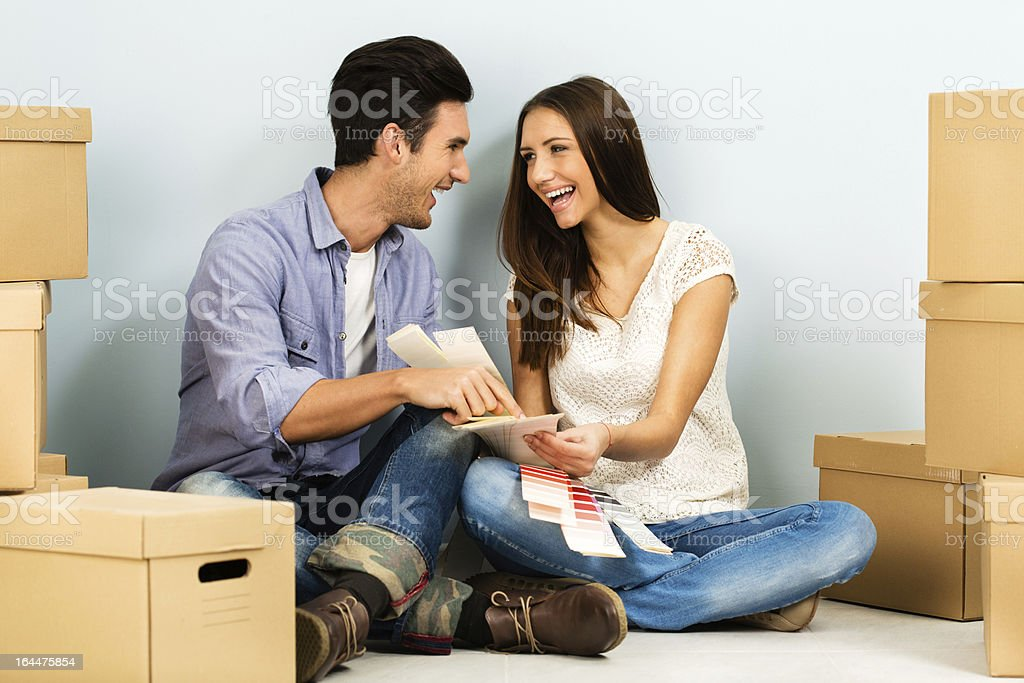 Young couple choosing paint swatches royalty-free stock photo