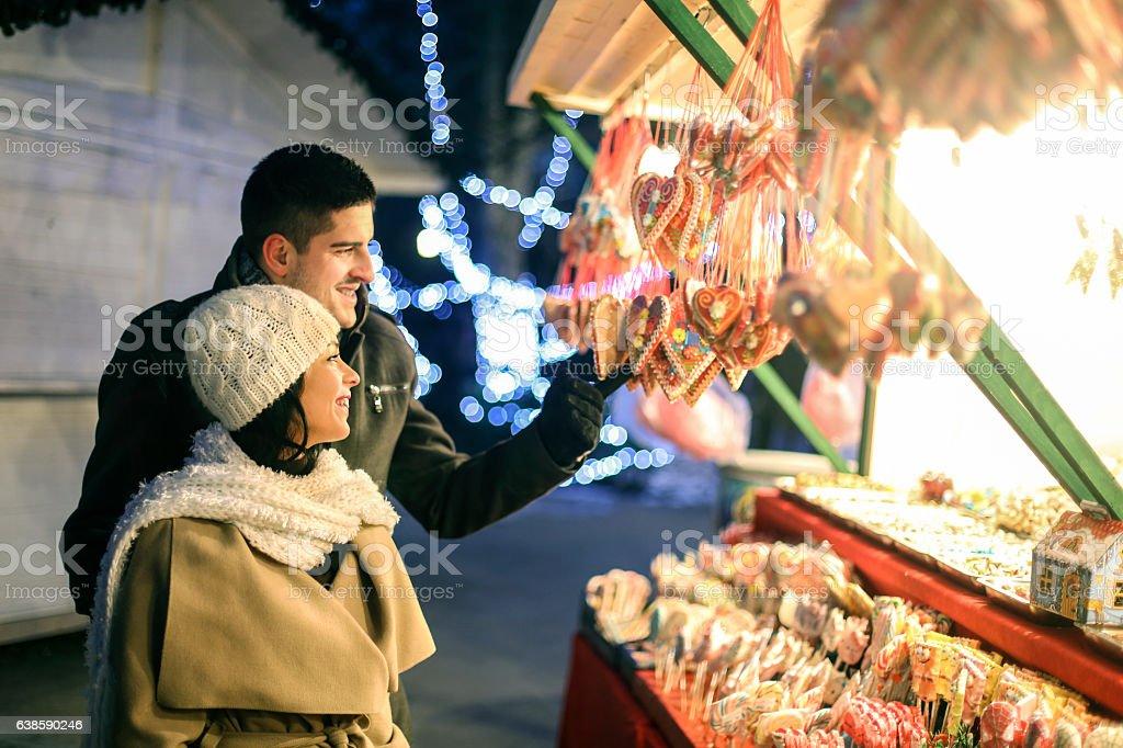 Young couple choosing sweet food stock photo