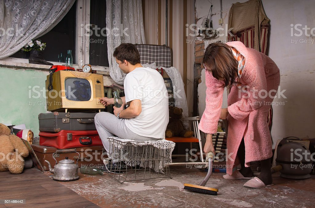 Cleaning Messy Room young couple cleaning a messy room stock photo 501466442 | istock
