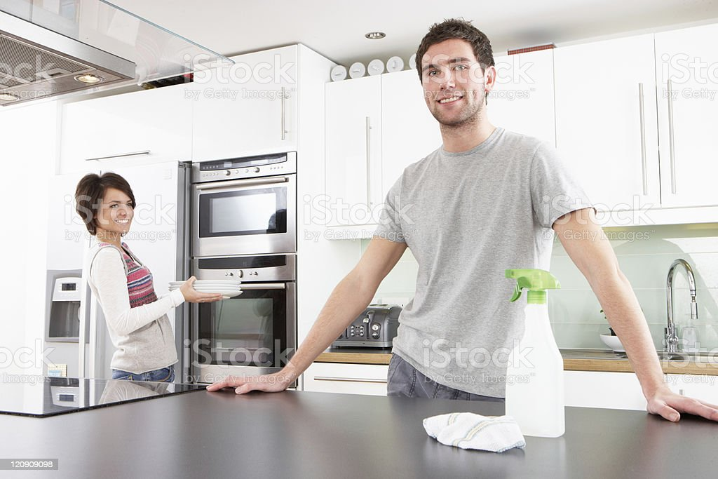 Young Couple Cleaning Kitchen stock photo