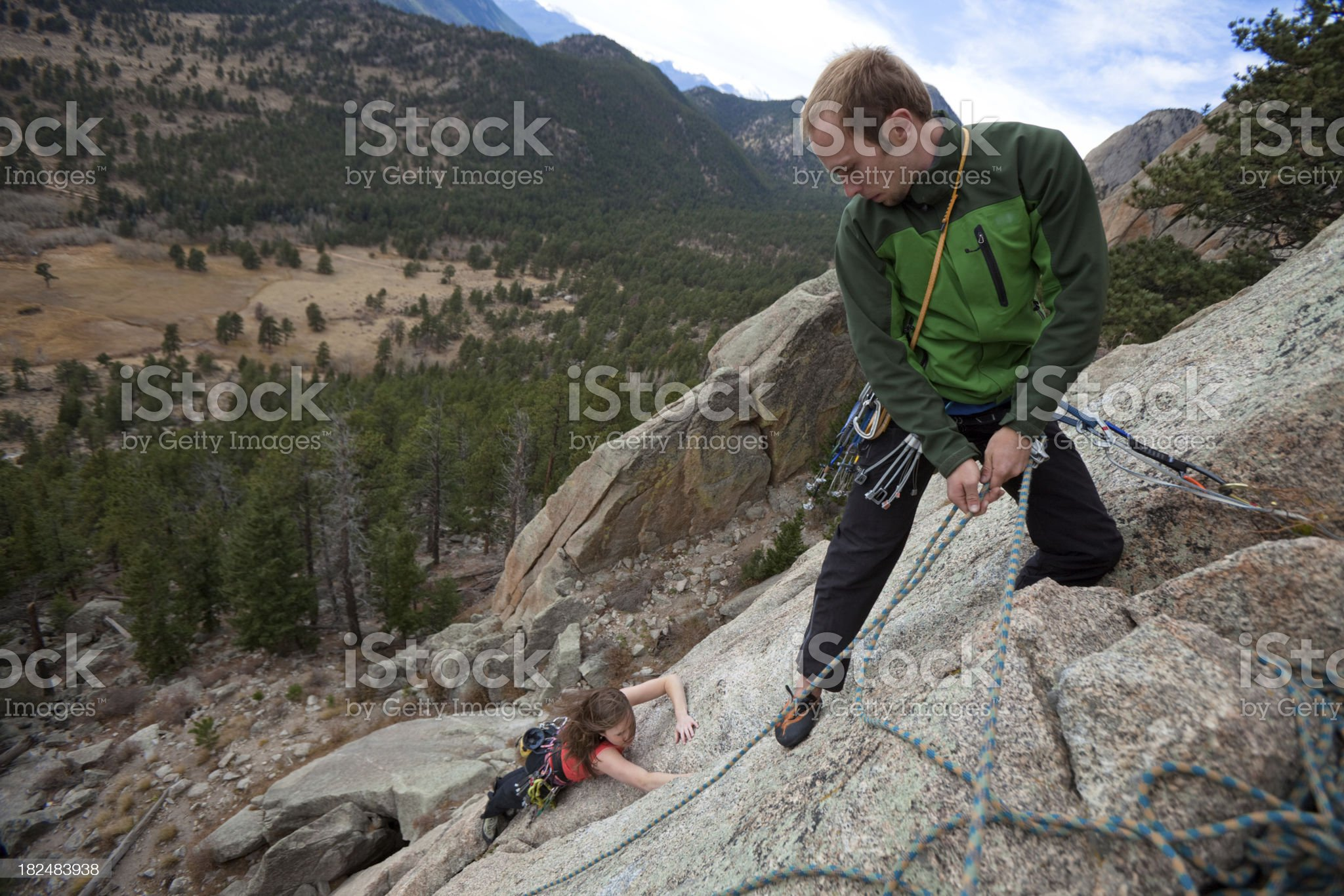 Young couple climbing together in Colorado royalty-free stock photo