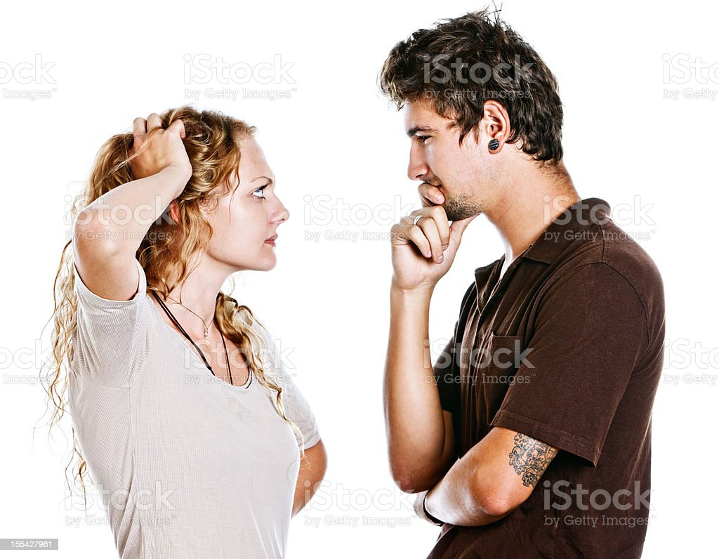 Young couple confront each other: isolated on white stock photo