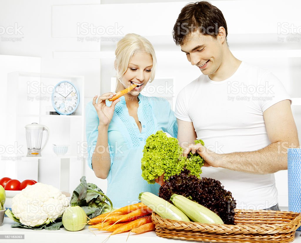 Young Couple Cooking and having fun in the Kitchen royalty-free stock photo