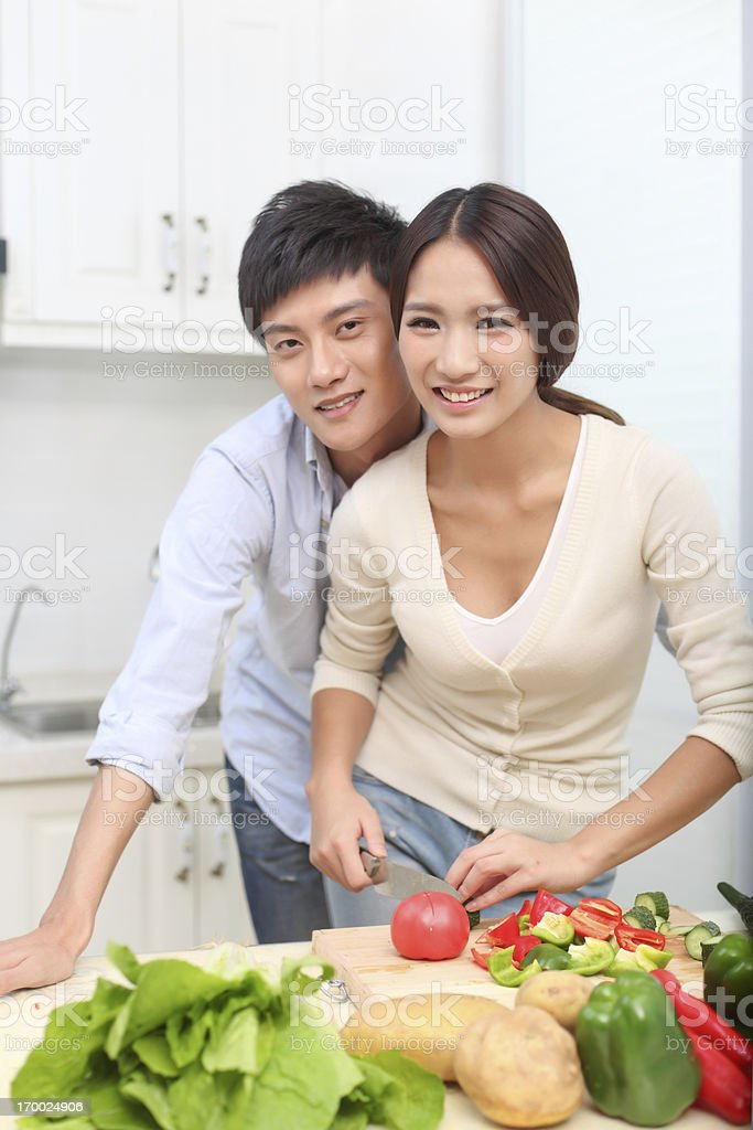Young Couple Cooking in the Kitchen royalty-free stock photo