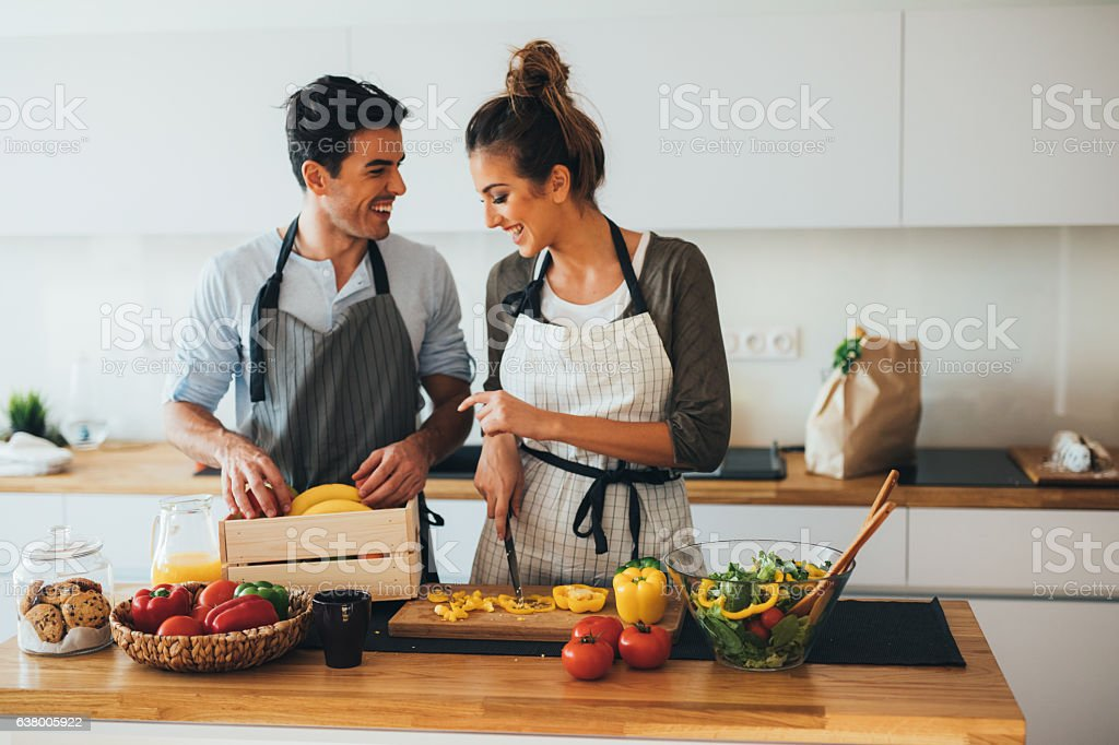 Young couple cooking in the kitchen stock photo