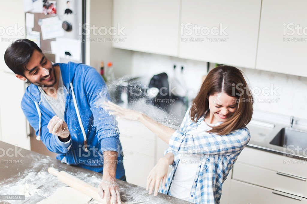 Young couple cooking together at home. stock photo