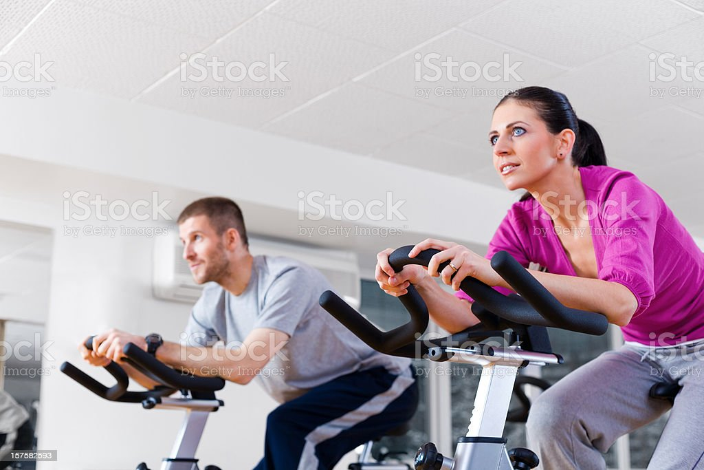 Young Couple Cycling At The Gym royalty-free stock photo