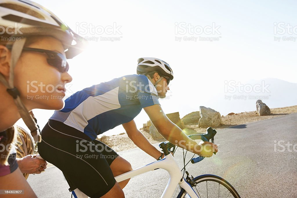 Young couple cycling in the countryside royalty-free stock photo