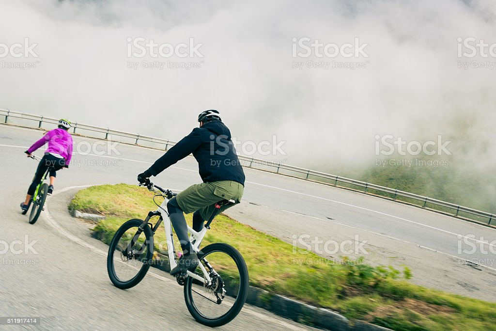 Young Couple Cycling stock photo