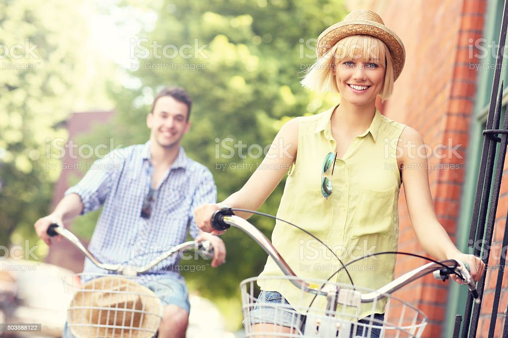 Young couple cycling together in the city stock photo