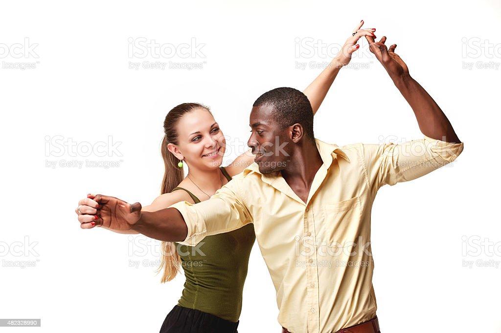 Young couple dances Caribbean Salsa, studio shot stock photo