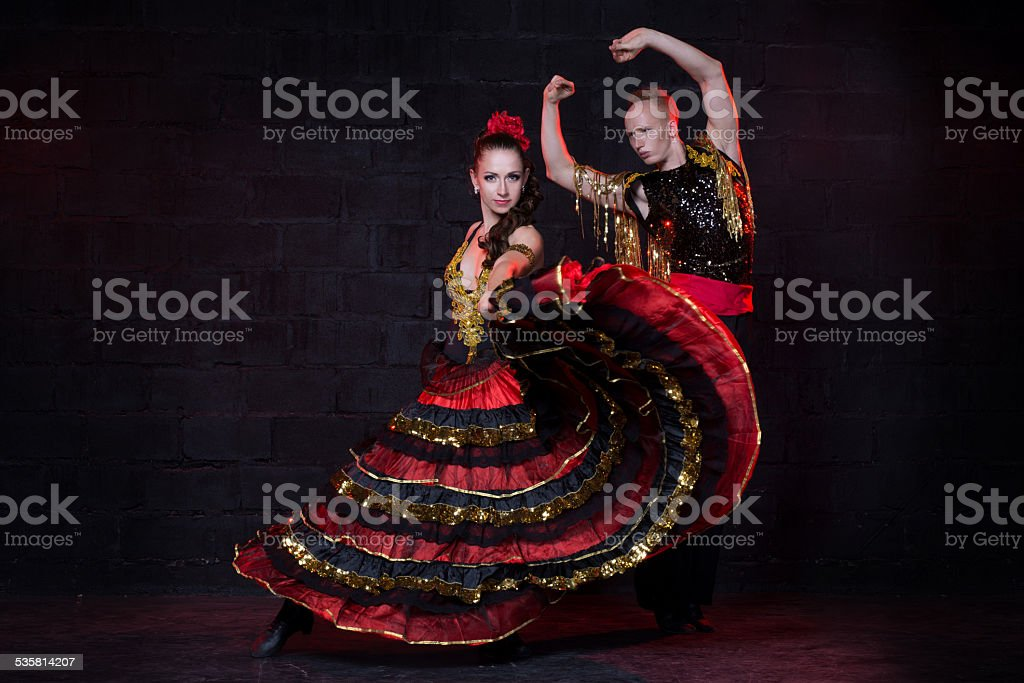 Young couple dancing flamenco, studio shot stock photo