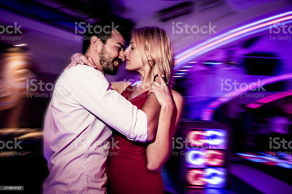 Young couple dancing in a nightclub royalty-free stock photo