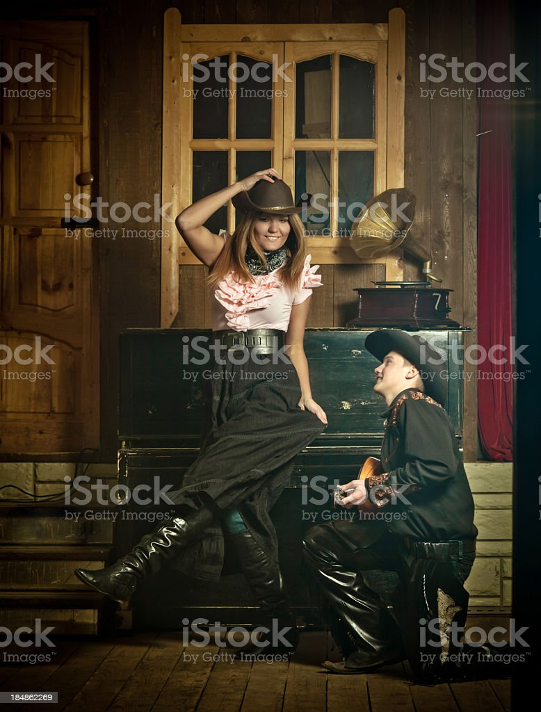 Young couple dancing in saloon stock photo