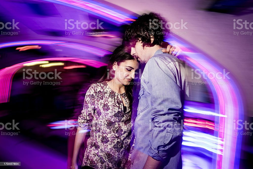Young couple dancing in the nightclub royalty-free stock photo