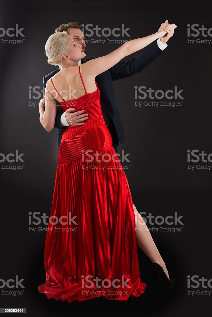 Young Couple Dancing On Black Background stock photo