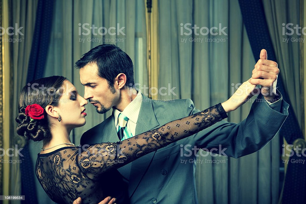 Young Couple Dancing Tango in Room royalty-free stock photo