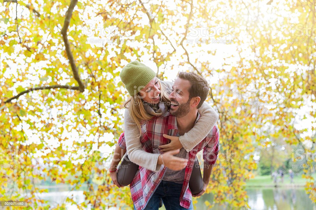 Young couple dating in park stock photo