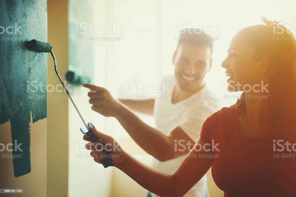 Young couple decorating apartment. stock photo