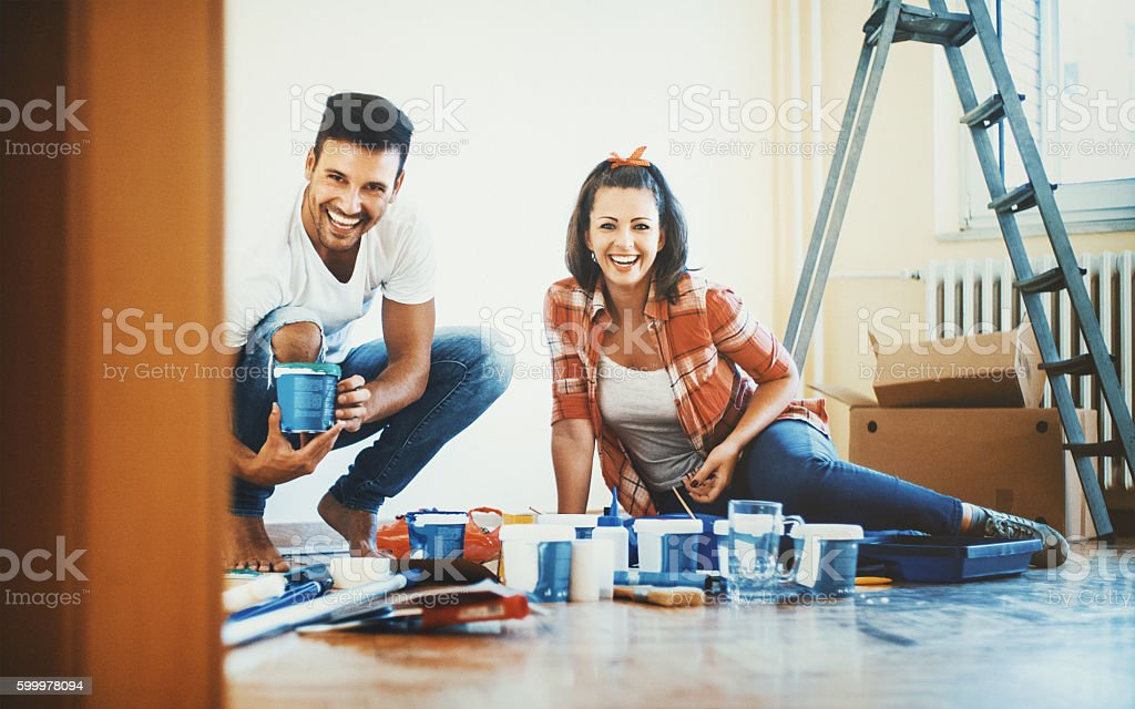 Young couple decorating apartment stock photo
