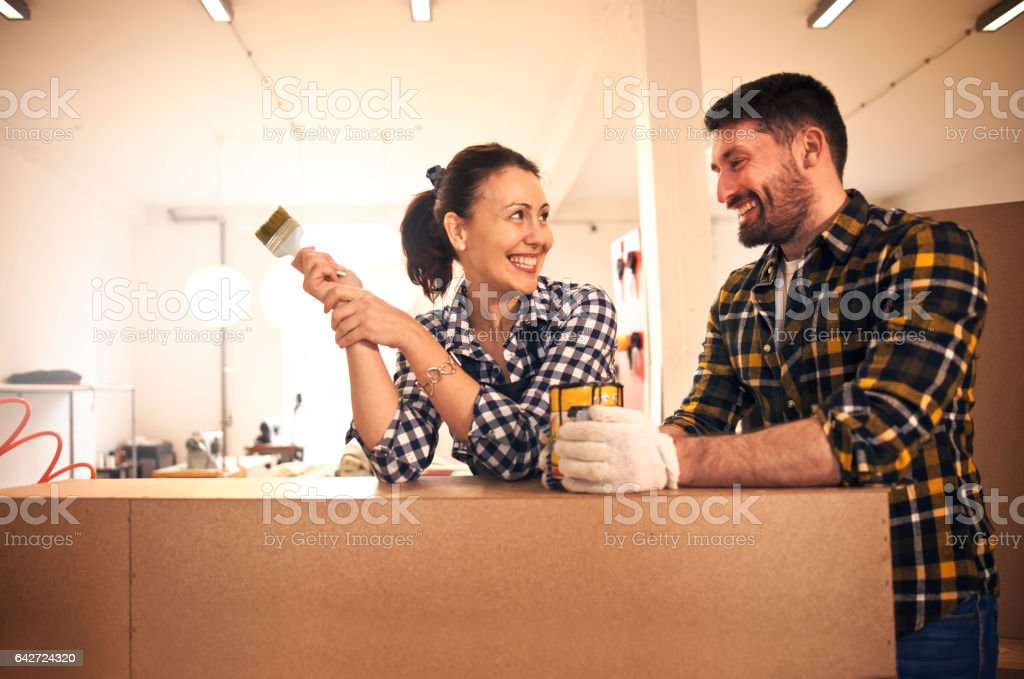 Young couple decorating stock photo