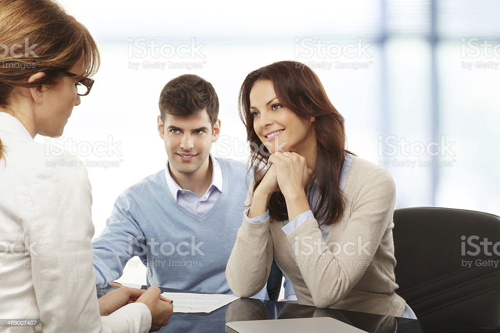 Young couple discussing financial plan with consultat stock photo