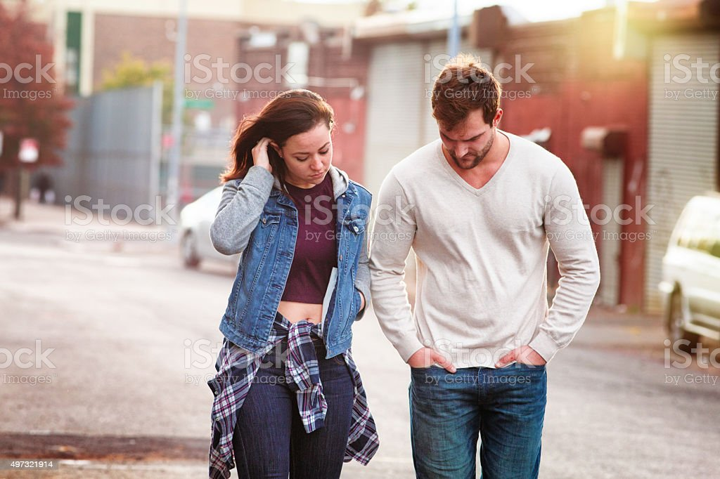 Young couple discussing relationship difficulties urban setting stock photo