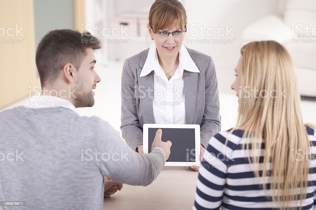 Young couple discussing with consultat stock photo