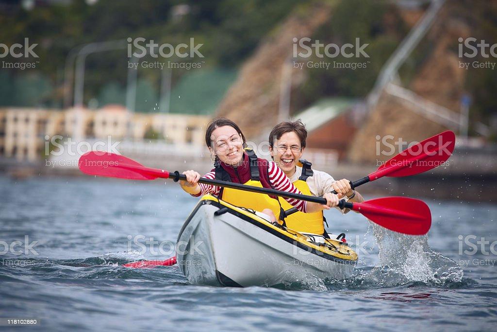 Young couple doing sea kayaking royalty-free stock photo