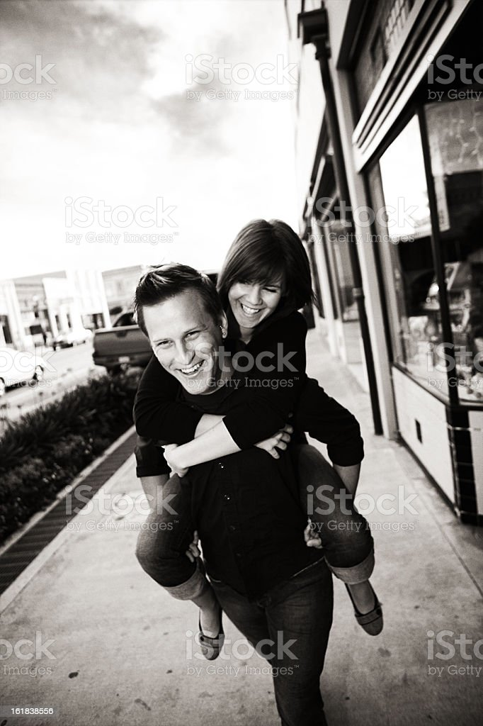 Young Couple Downtown Giving Piggy Back Ride stock photo