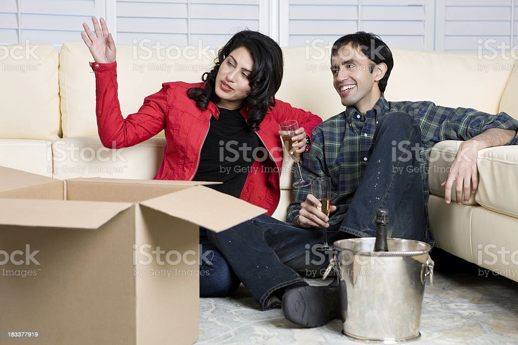 Young Couple Dream About Furnishing Their House royalty-free stock photo