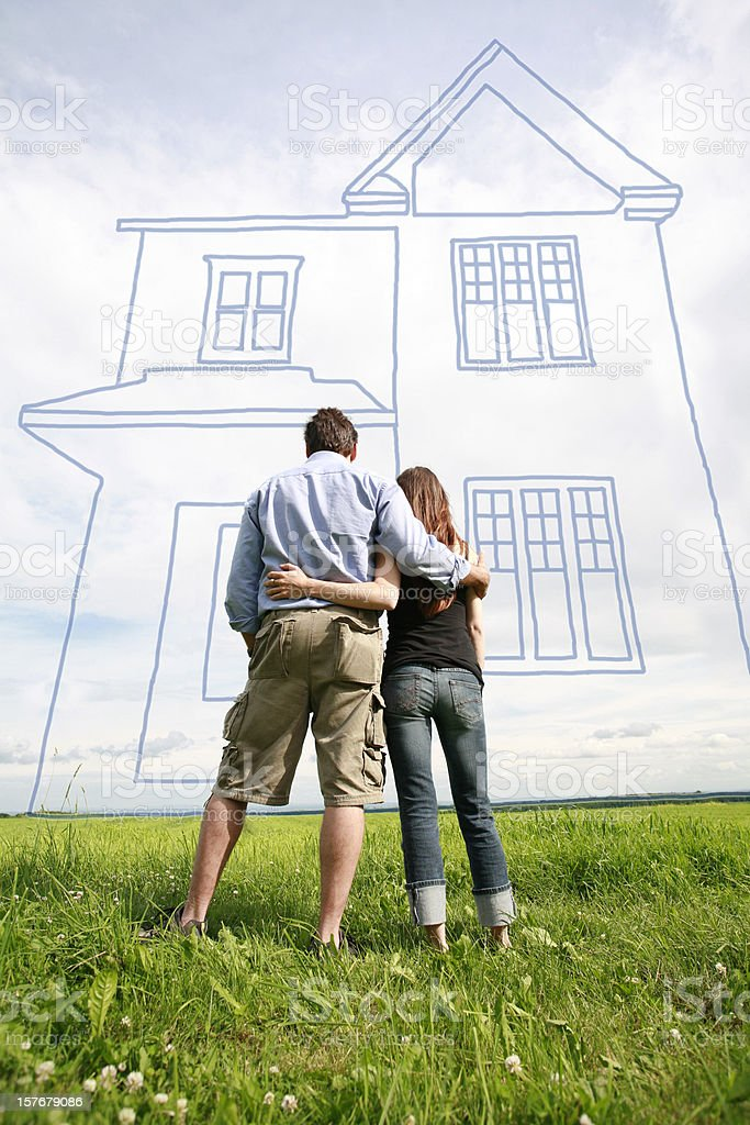 Young couple dreaming of their new home. stock photo