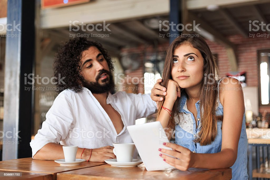 Young couple drinking coffee in cafe stock photo