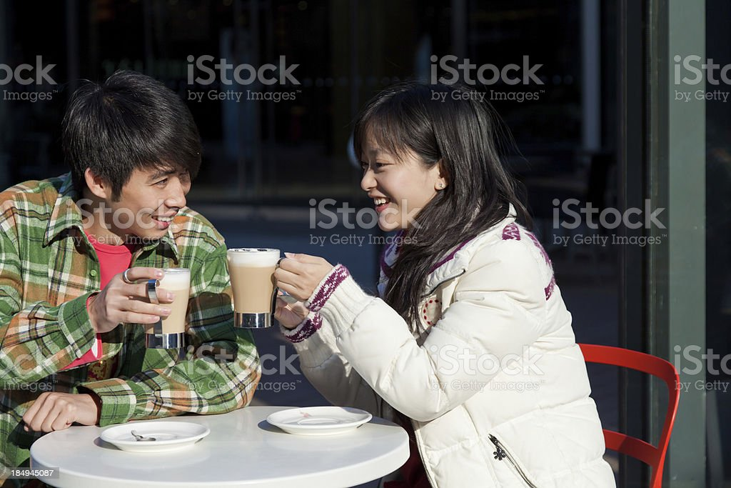 young couple drinking coffee in the dating royalty-free stock photo