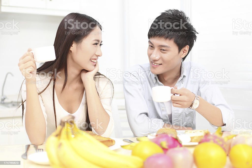 Young couple drinking coffee in the kitchen royalty-free stock photo