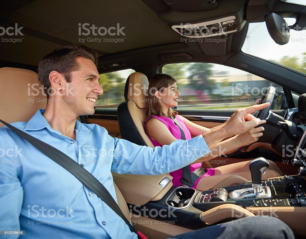 Young couple driving in car stock photo