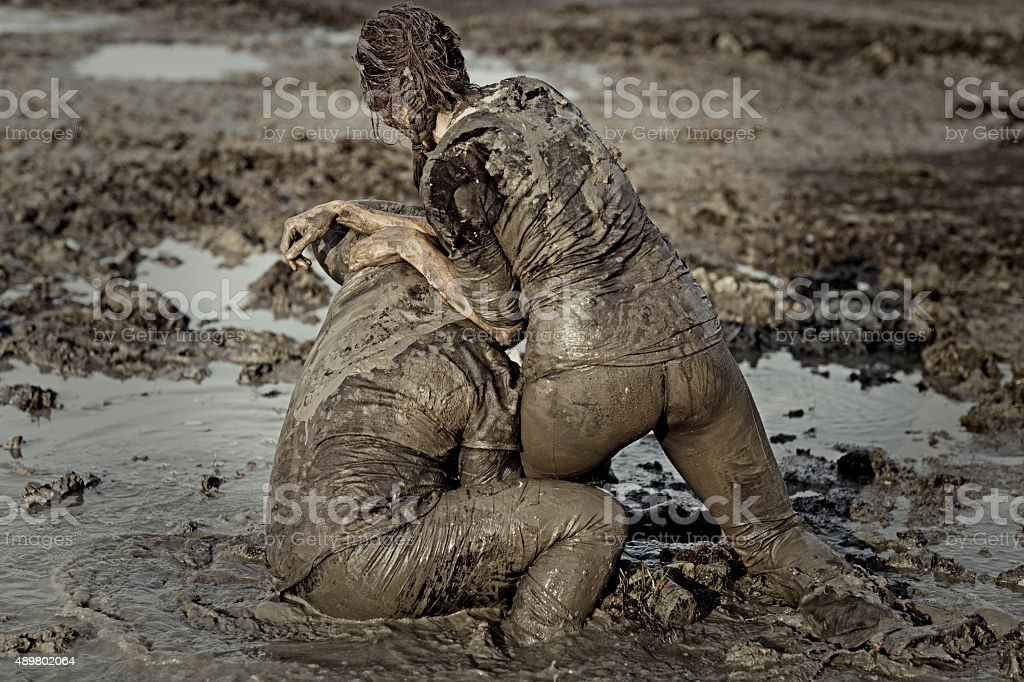 Young couple during a mud run stock photo