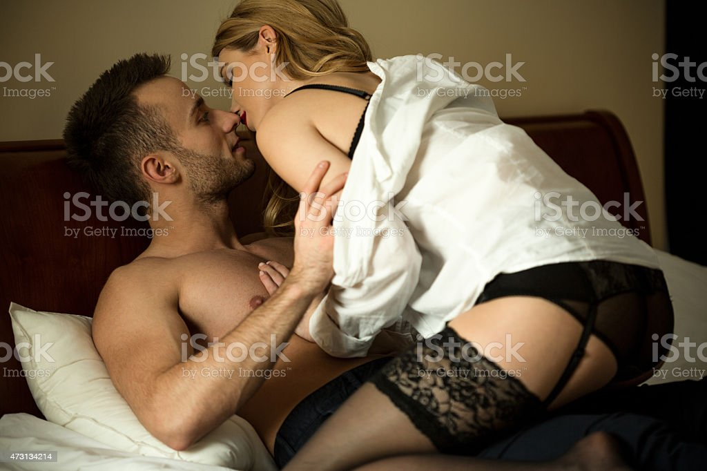 Young couple during foreplay stock photo