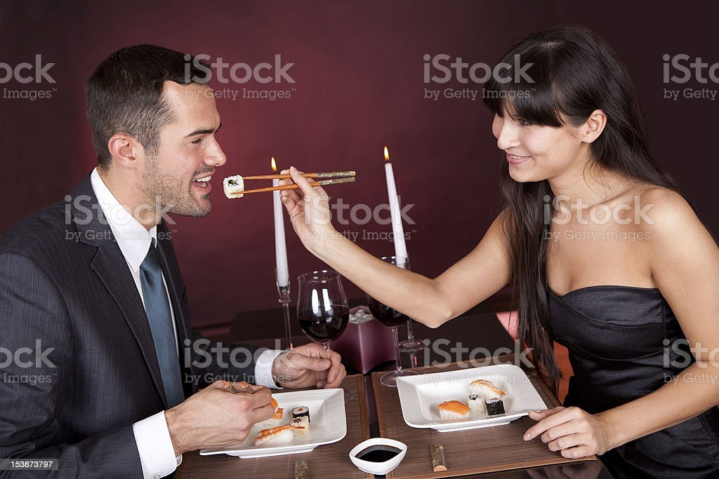 Young couple eating sushi in restaurant royalty-free stock photo