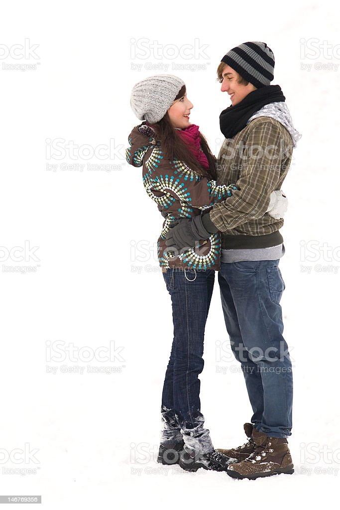 Young couple embracing in snow royalty-free stock photo